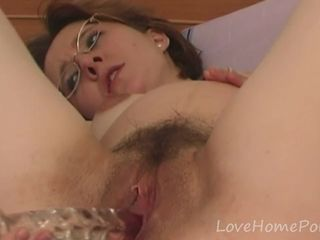 Mature with glasses fills up her love..