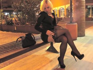Hot & sexy blonde MILF walking in tight..