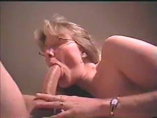 Blonde mature whore sucks a cock that..