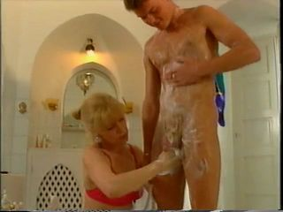 granny helping young guy to get clean in..
