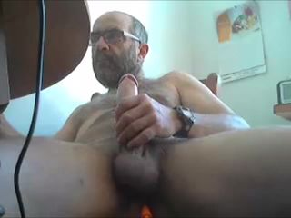Mature guy shoots his load with a dildo..