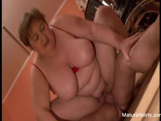 Chubby mature gets both holes fucked in..