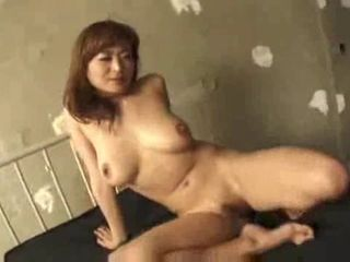 Mature Japanese in Threesome is DP'ed